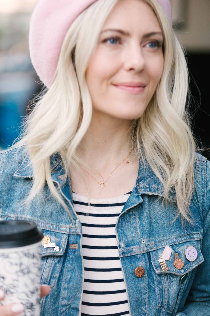 Katie Dean wearing the gold Sphere Necklace with a jean jacket.