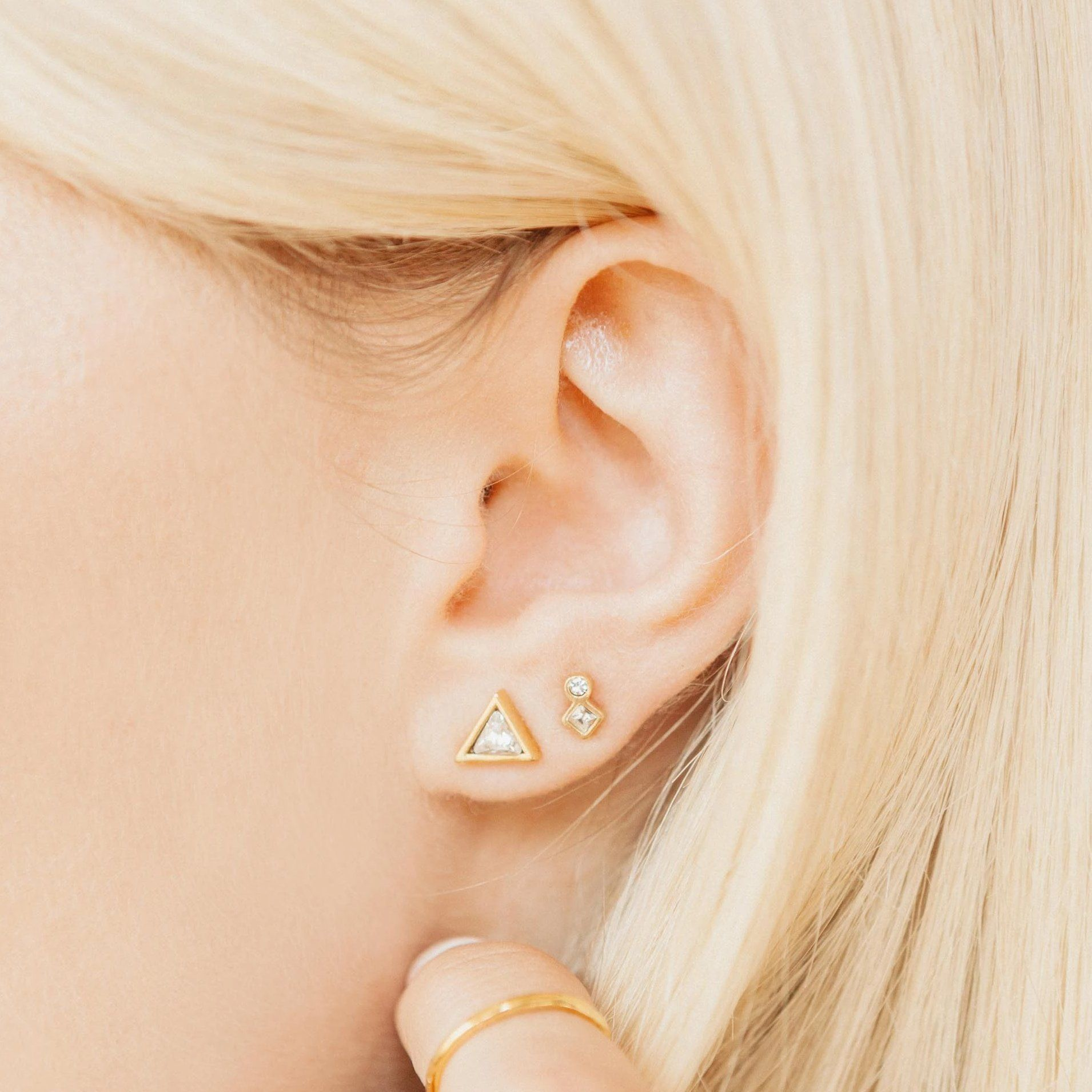 Image of model wearing the gold Geo Mini Studs.