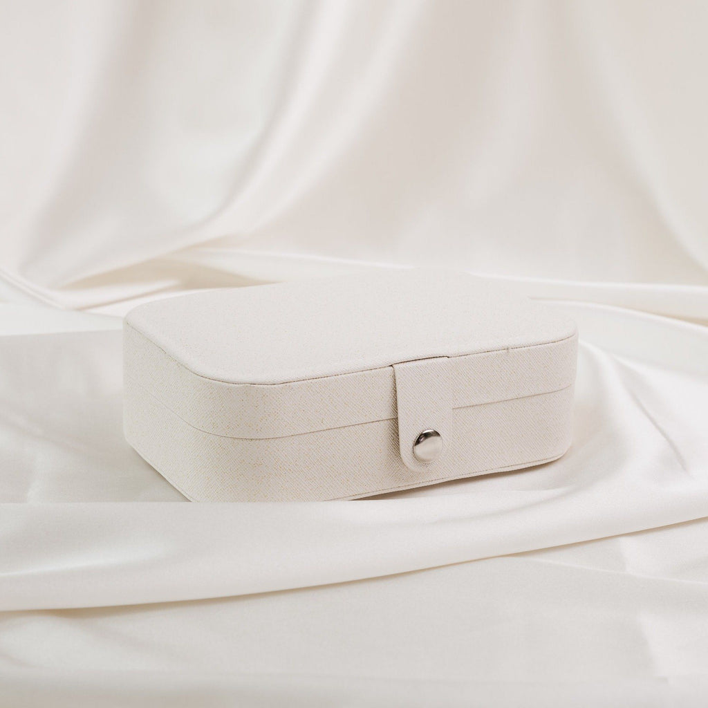 White jewelry case on satin katie-dean-jewelry