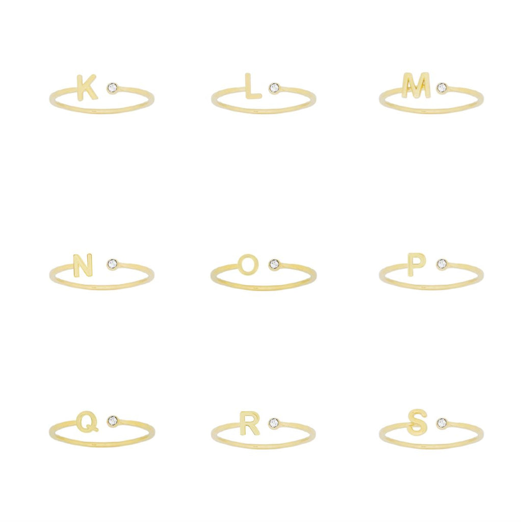 Gold dainty Initial Rings on a white background, letters shown K, L, M, N, O, P, Q, R, S