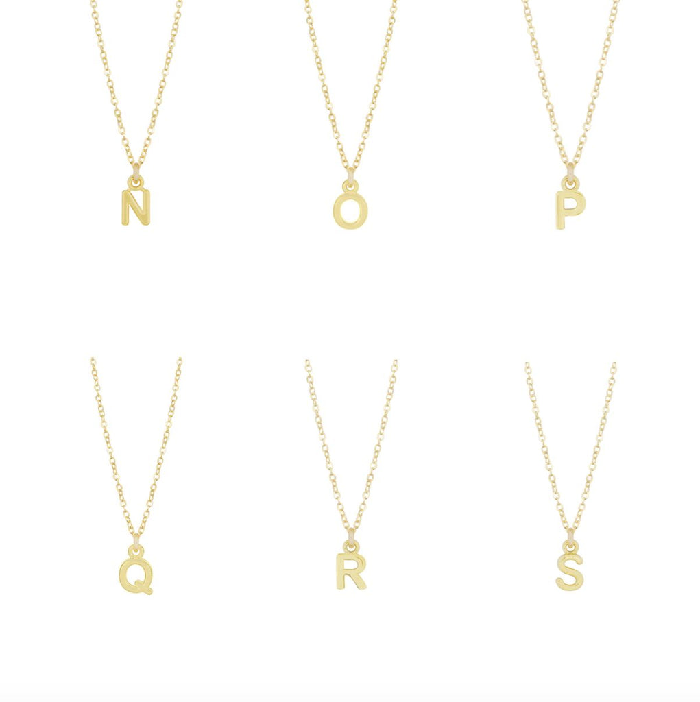 "Dainty gold Initial Necklaces ""N, O, P, Q, R, S""  shown on a white background, made by Katie Dean Jewelry."