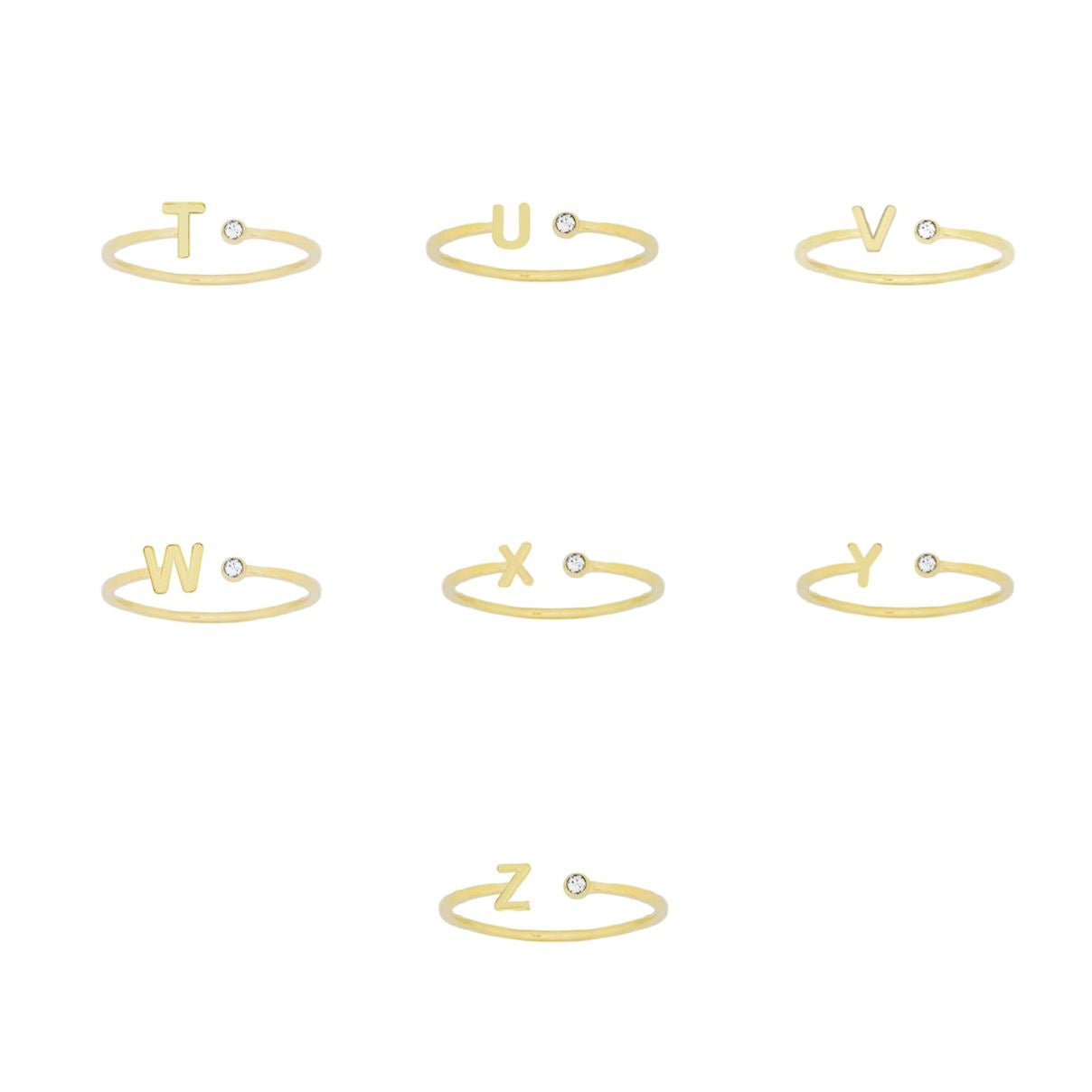 Gold dainty Initial Rings on a white background, letters shown T, U, V, W, X, Y, Z