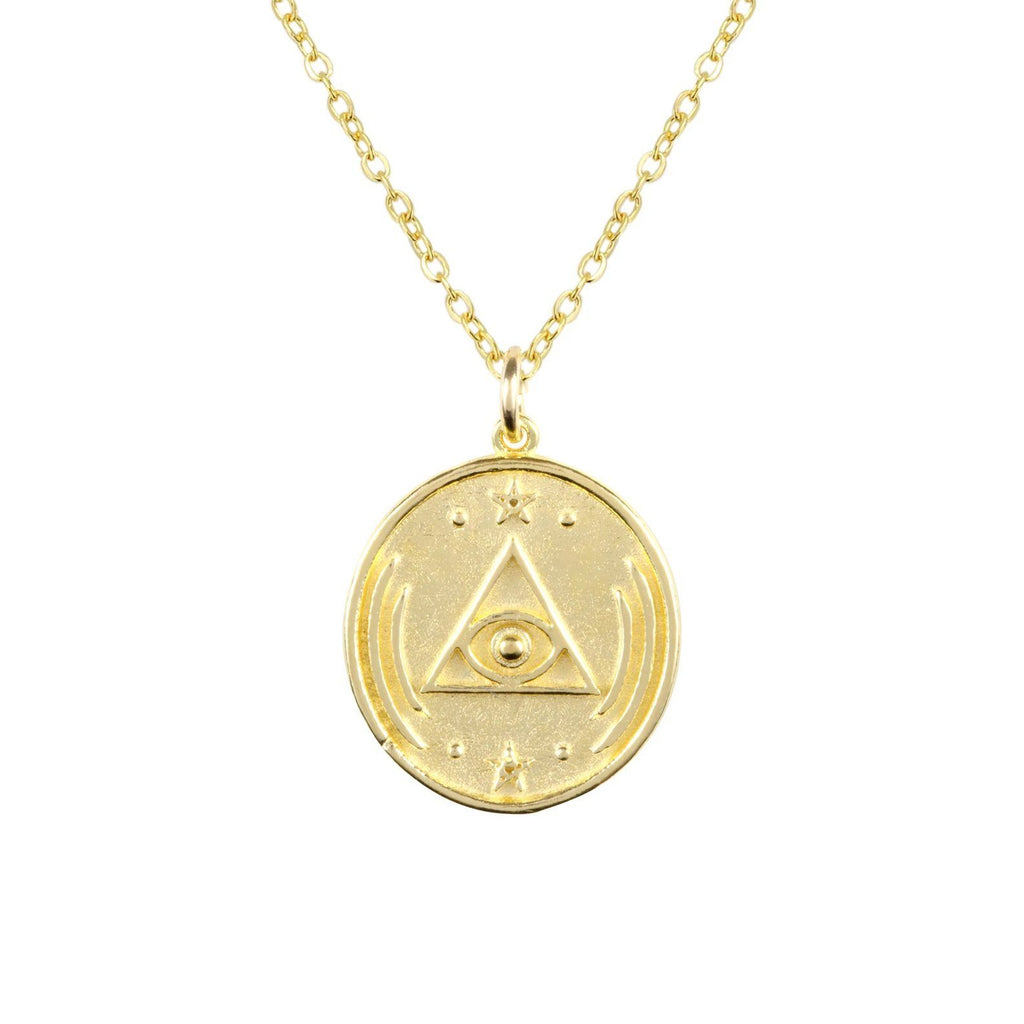 Gold and dainty All Seeing Eye Necklace against a white background, circular in shape with a triangle and eye design in the middle of the charm.
