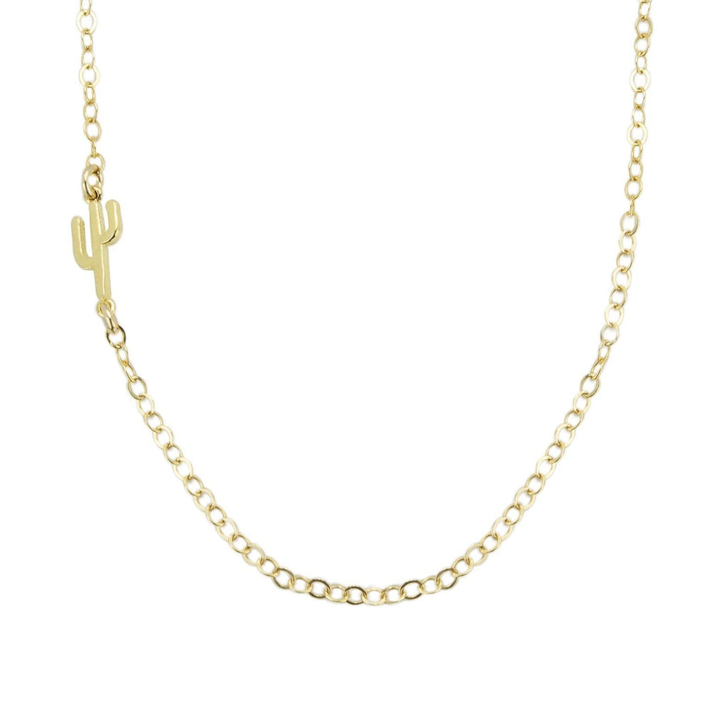 Up close image of gold Cactus Necklace chain with a tiny cactus pendant against a white background.
