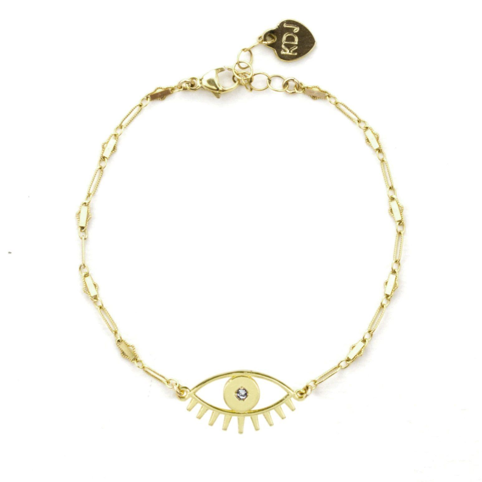 Up close image of the gold Evil Eye Bracelet against a white background.