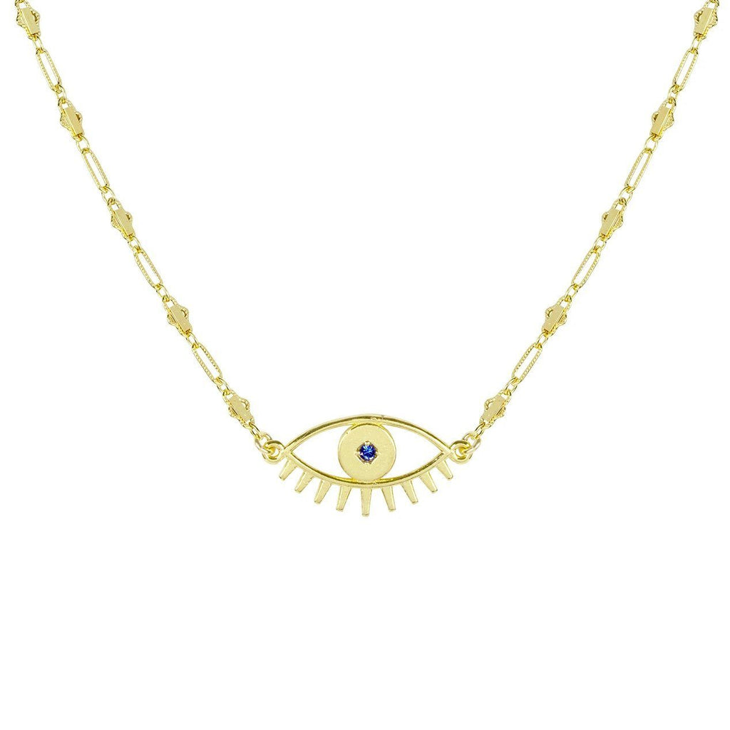 Up close image of the gold Evil Eye Necklace pendant against a white background.