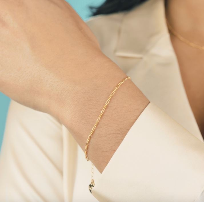 Simple and classic. The Figaro Chain Bracelet is the perfect dainty bracelet to pair up with your order dainty chain bracelets.  Handmade in California by Katie Dean Jewelry.