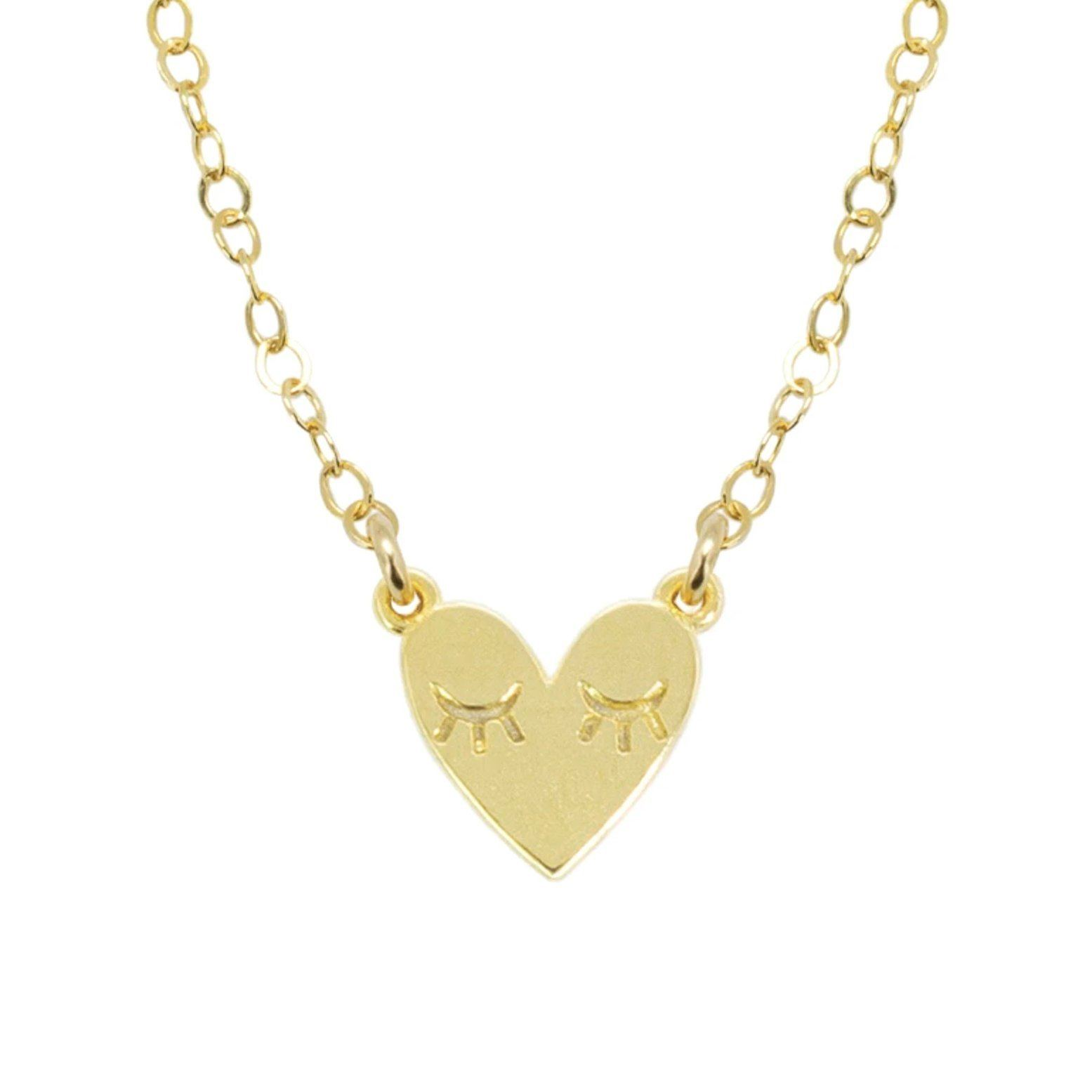 Up close image of the gold Heart Necklace pendant.