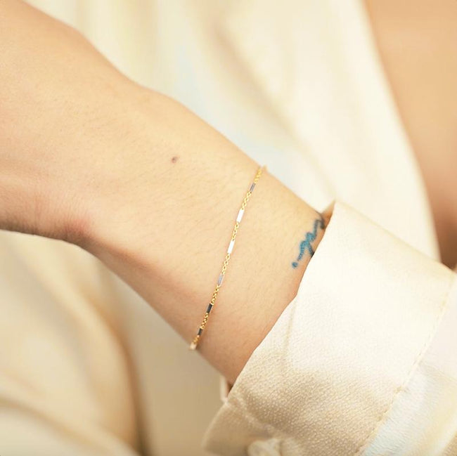 Silver and gold came together to form the perfect friendship in the form of this dainty bracelet. Silver and gold lovers alike agree on this one!  Handmade in California by Katie Dean Jewelry.