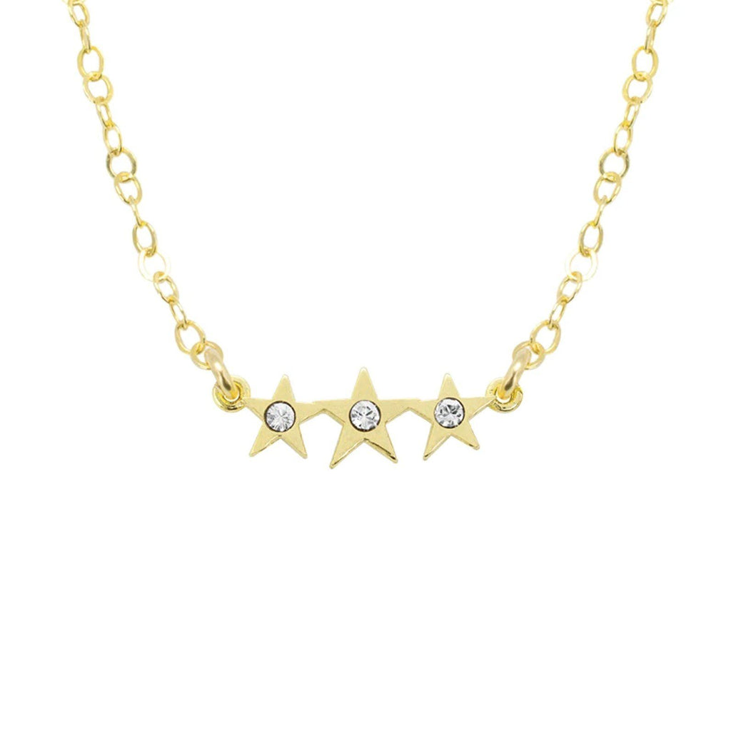Up close image of the gold Starburst Necklace with tiny crystals & three stars.