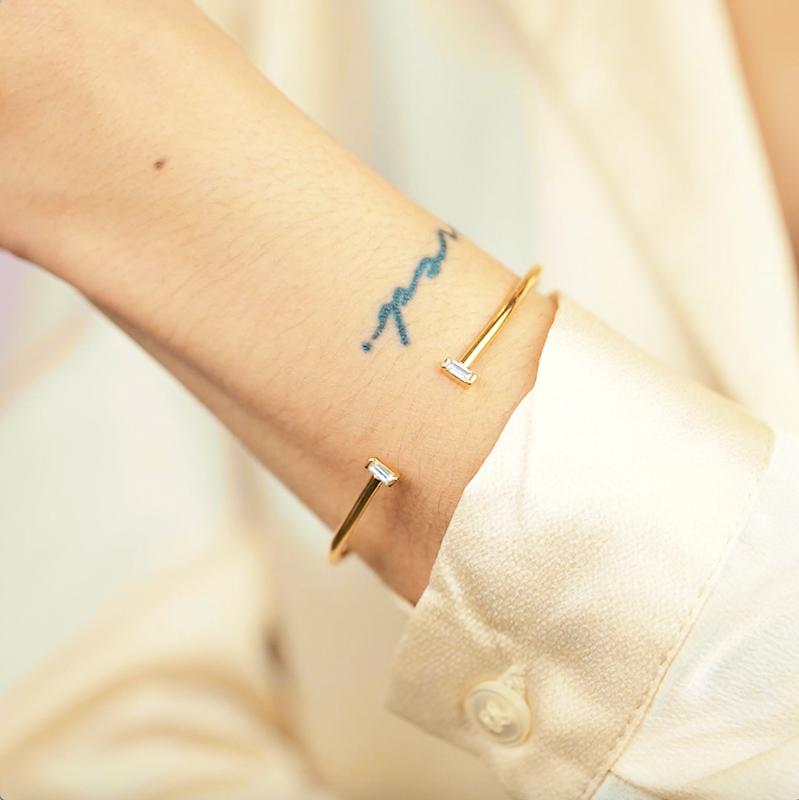 Model wearing the gold Baguette Cuff. Handmade in California by Katie Dean Jewelry.