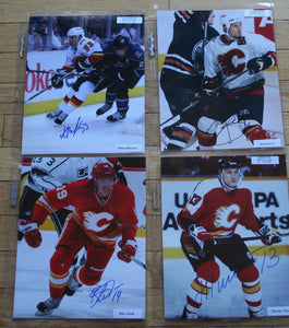 Lot of 4 Autographed Calgary Flames 8x10 Photos  c/w COA  FREE SHIPPING  Babchuk, Boughner, Jones, Titov  NHL Hockey Memorabilia