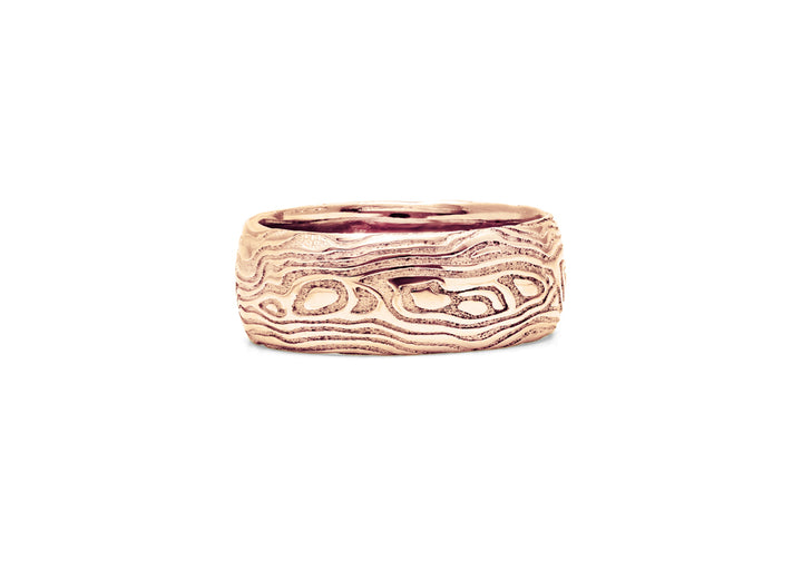 wedding ring man pink gold wooden guy