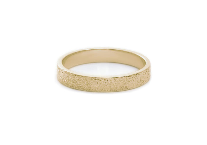 single crosspiece yellow gold wedding rings woman unique texture