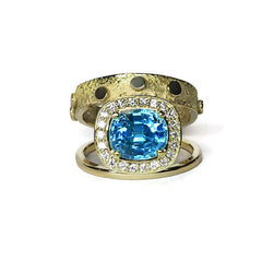 bague zircon bleu et diamants or jaune double signature halo