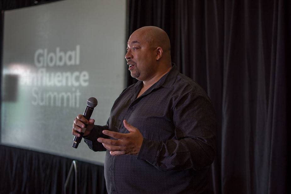 Dr. Ganz speaking at the 2019 Global Influence Summit