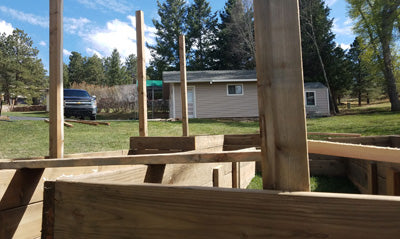setting fence posts for a fence around my raised garden
