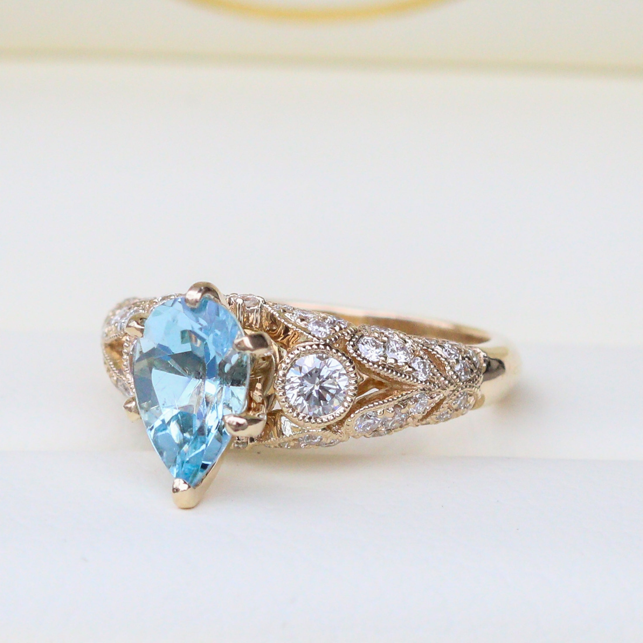 Custom engagement ring with aquamarine center