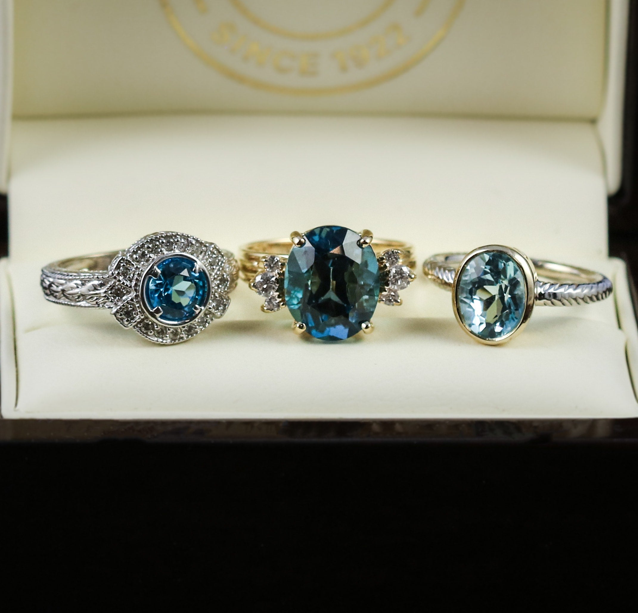 Blue topaz and diamond rings