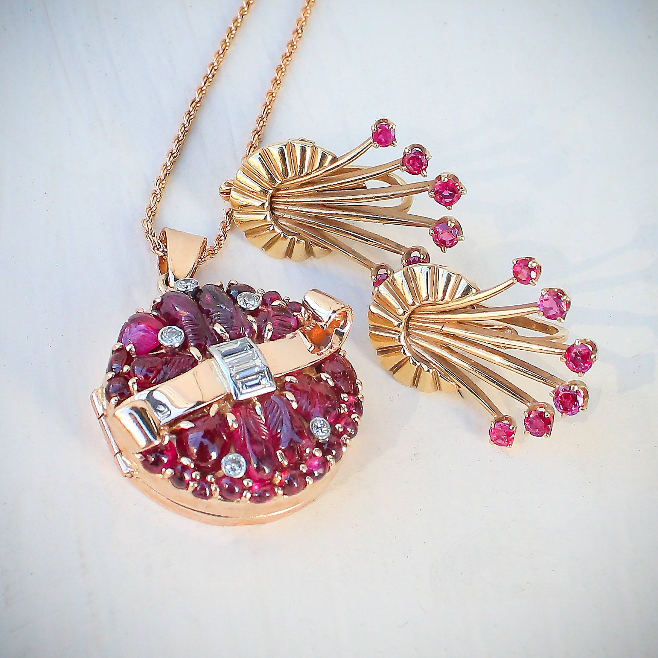 1940's retro rose gold ruby and diamond pendant earrings.