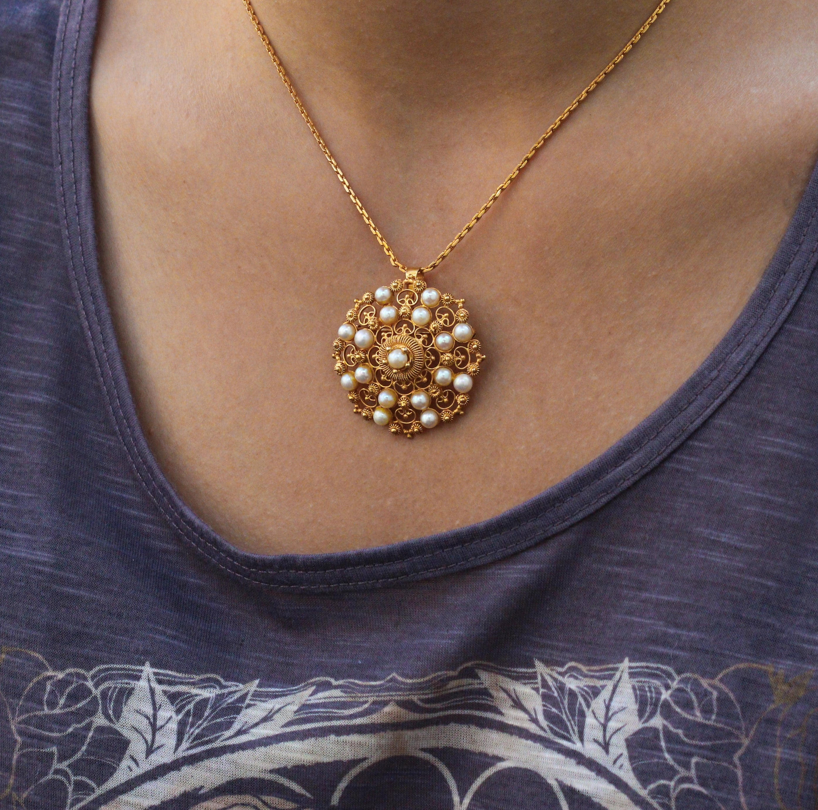 Vintage Etruscan style yellow gold and pearl pendant.