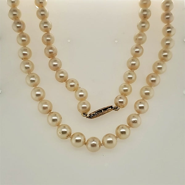 "24"""""""" long 7x6.5mm cultured Akoya pearl necklace"