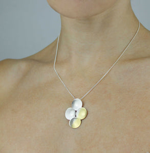 Handmade contemporary silver and gold-plated pendant