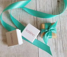 Gift-wrapped jewellery boxes with ribbons