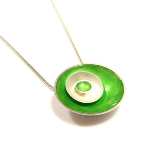 Handmade silver disc pendant with green enamel