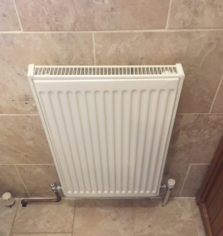 removing a radiator from a tiled wall - removing radiator from bathroom