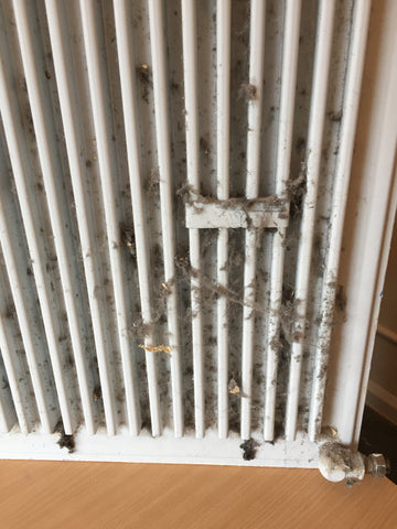 How to clean dirty radiators - dust gathering behind radiators - how to clean central heating radiator