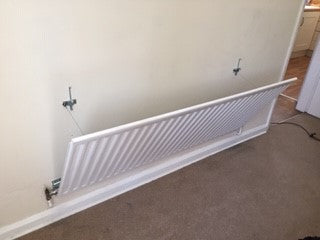 how to remove radiator from wall for decorating and cleaning