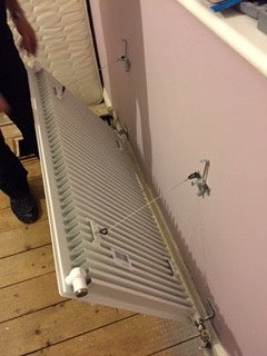 removing a radiator from the wall
