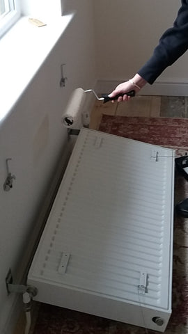 how to paint behind a radiator - paint roller behind radiator