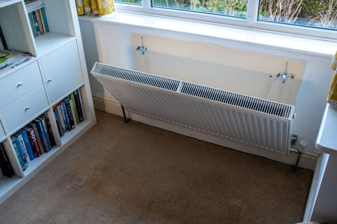 Removing a radiator from the wall for cleaning - allergies - case study - Rotarad