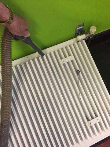 how to remove a radiator from the wall for cleaning