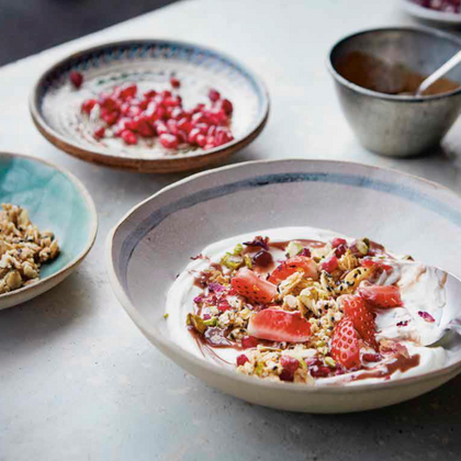 Fruit and yogurt with sesame oat crumble and tahini-date syrup