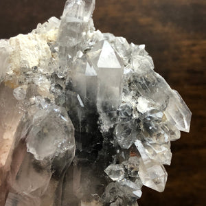 Phantom Quartz Crystal Cluster on a bed of white Adularia