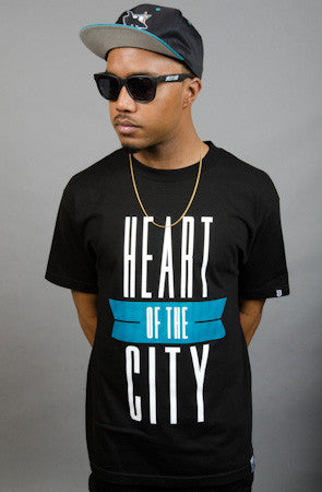 Breezy Excursion X Adapt :: Heart of the City (Men's Black/Teal Tee)