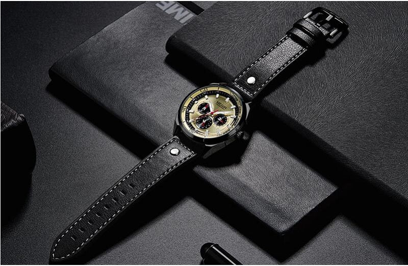 gold dial black strap watch