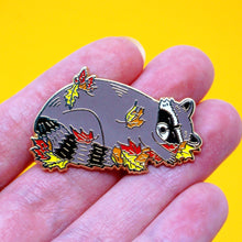 Load image into Gallery viewer, Sleeping raccoon in fall leaves enamel pin