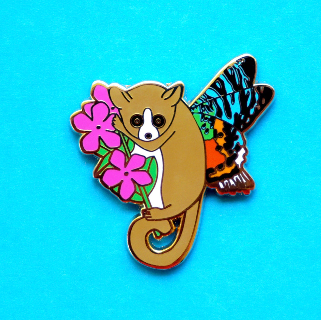 Mouse lemur moth enamel pin