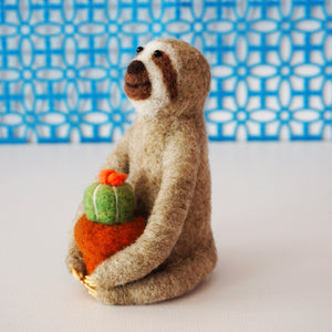 Needle felted sloth with blooming cactus plant