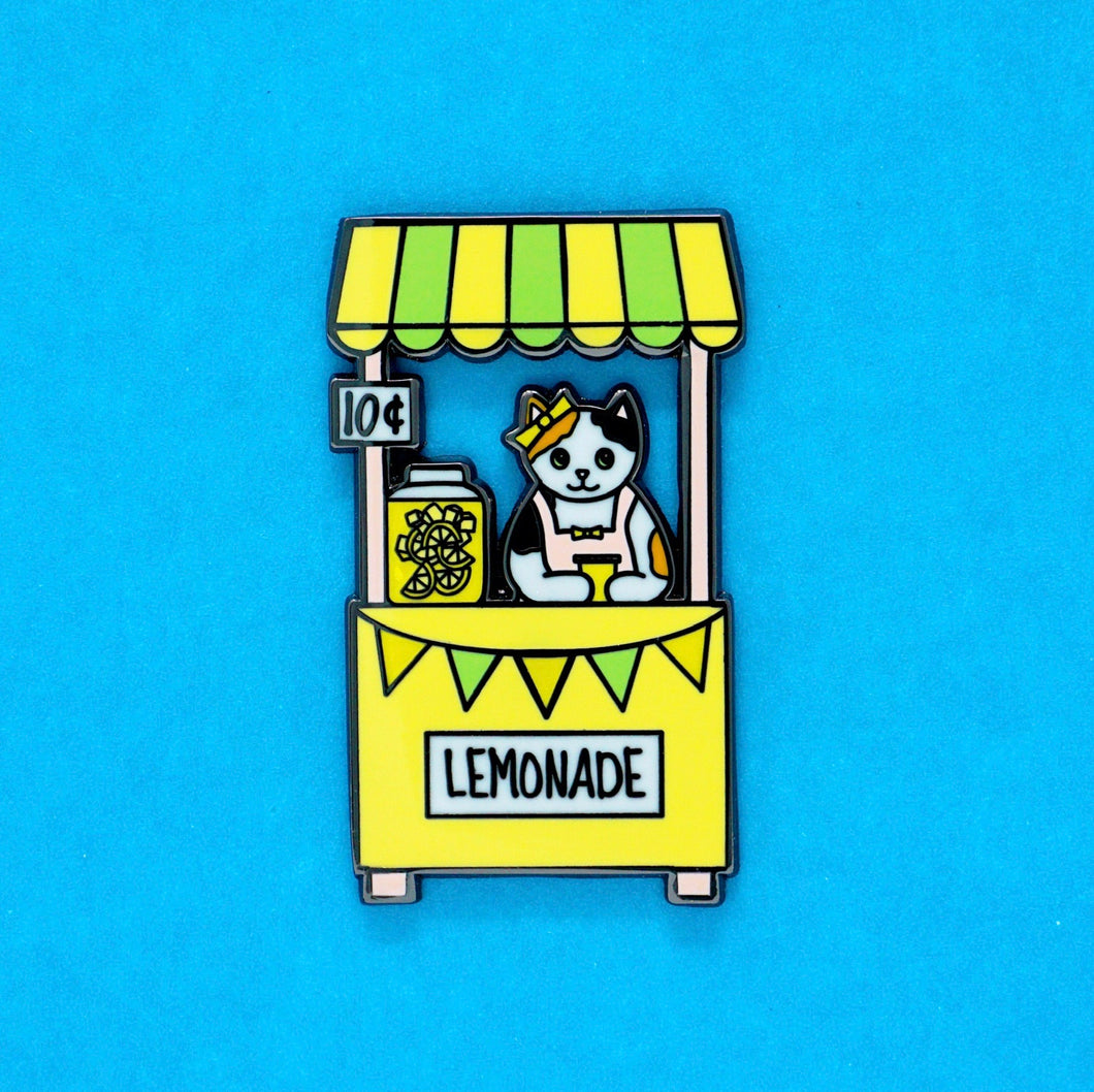 Lemonade stand cat enamel pin