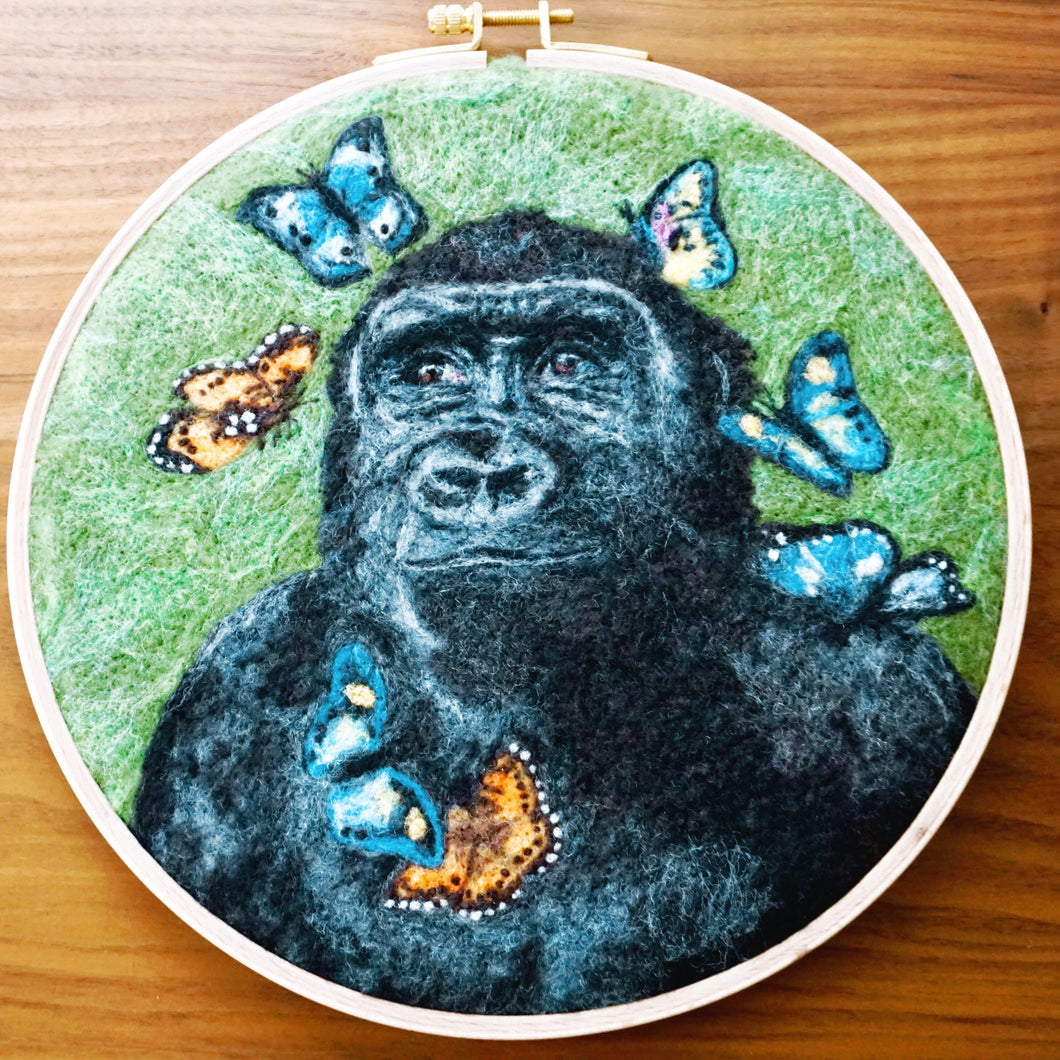 Wool painting of gorilla with butterflies
