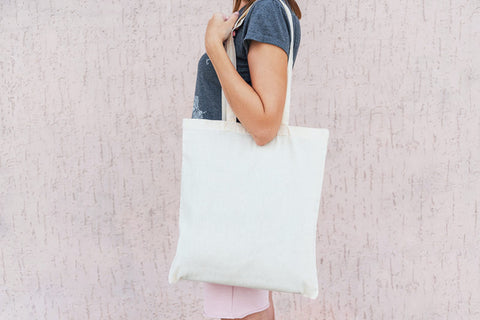 woman with reusable canvas tote bag