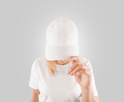 woman with blank hat and blank tee