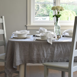 Grey Linen Tablecloth with White Linen and Crockery