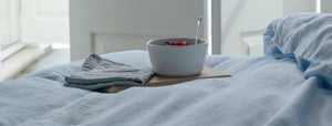 Whisper Pale Blue Linen Bedding with a Breakfast Bowl