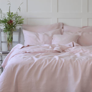 Pink Linen Duvet Cover with Flowers on a Bedside Table